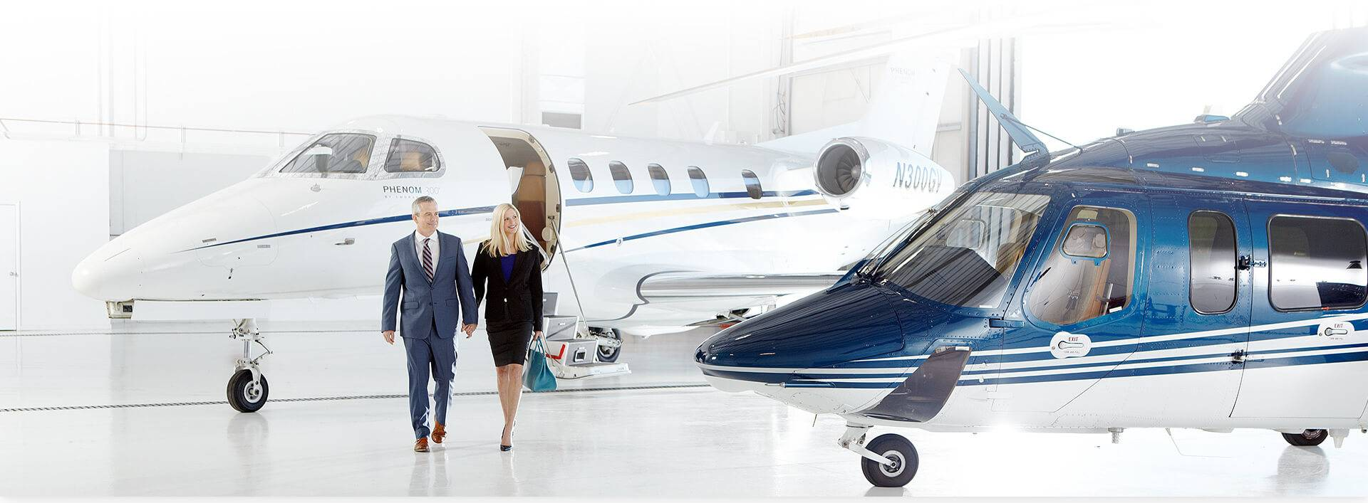 Couple walking out of a Grandview aviation jet